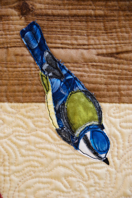quilted blue tit