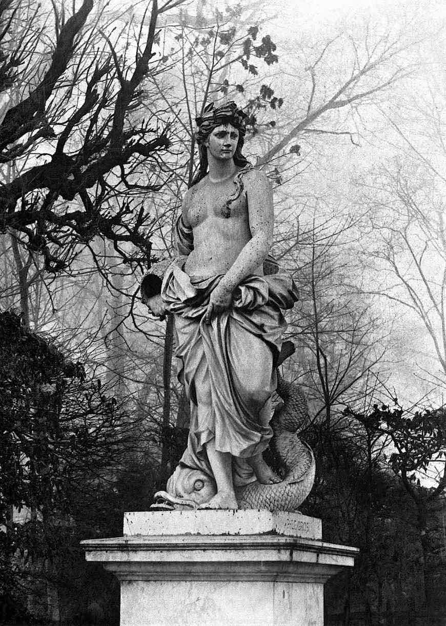 a clear old photograph of a Versailles palace statue