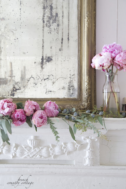 Antique fireplace mantel peonies and mirror