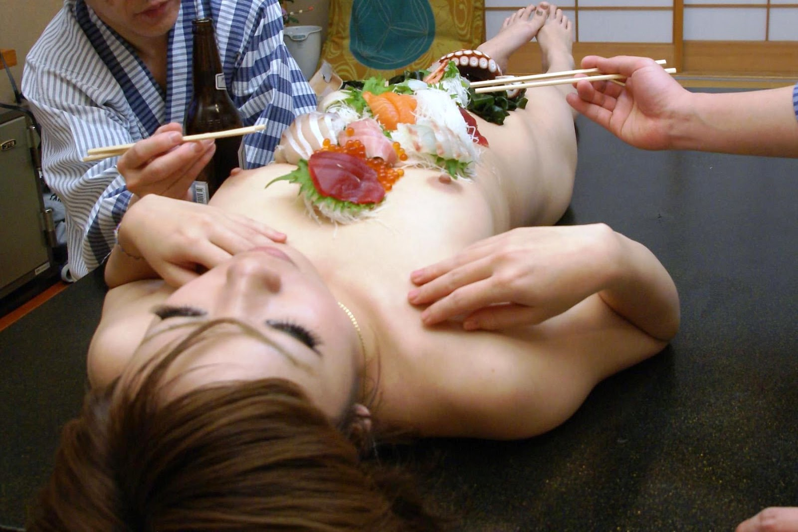 Nyotaimori, lxurious ingredients served on body of naked women originated in Ishikawa Prefecture and continues to be practiced there.
