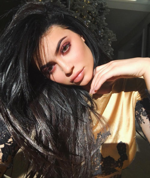 Kylie Jenner strikes seductive pose as she continues promotion of her online store