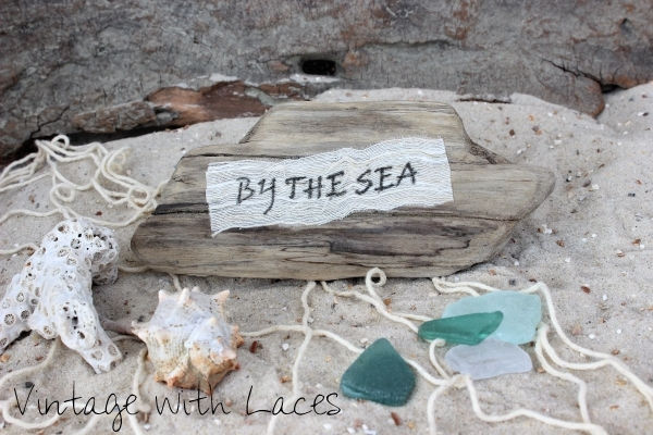 Coastal Decor: Driftwood pieces embellished with stamped fabric scraps