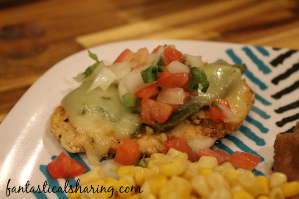 Green Chile Chicken // Roasted poblanos, cheese, and pico de gallo are simply fabulous paired with the smokey marinated chicken #recipe #chicken #poblano