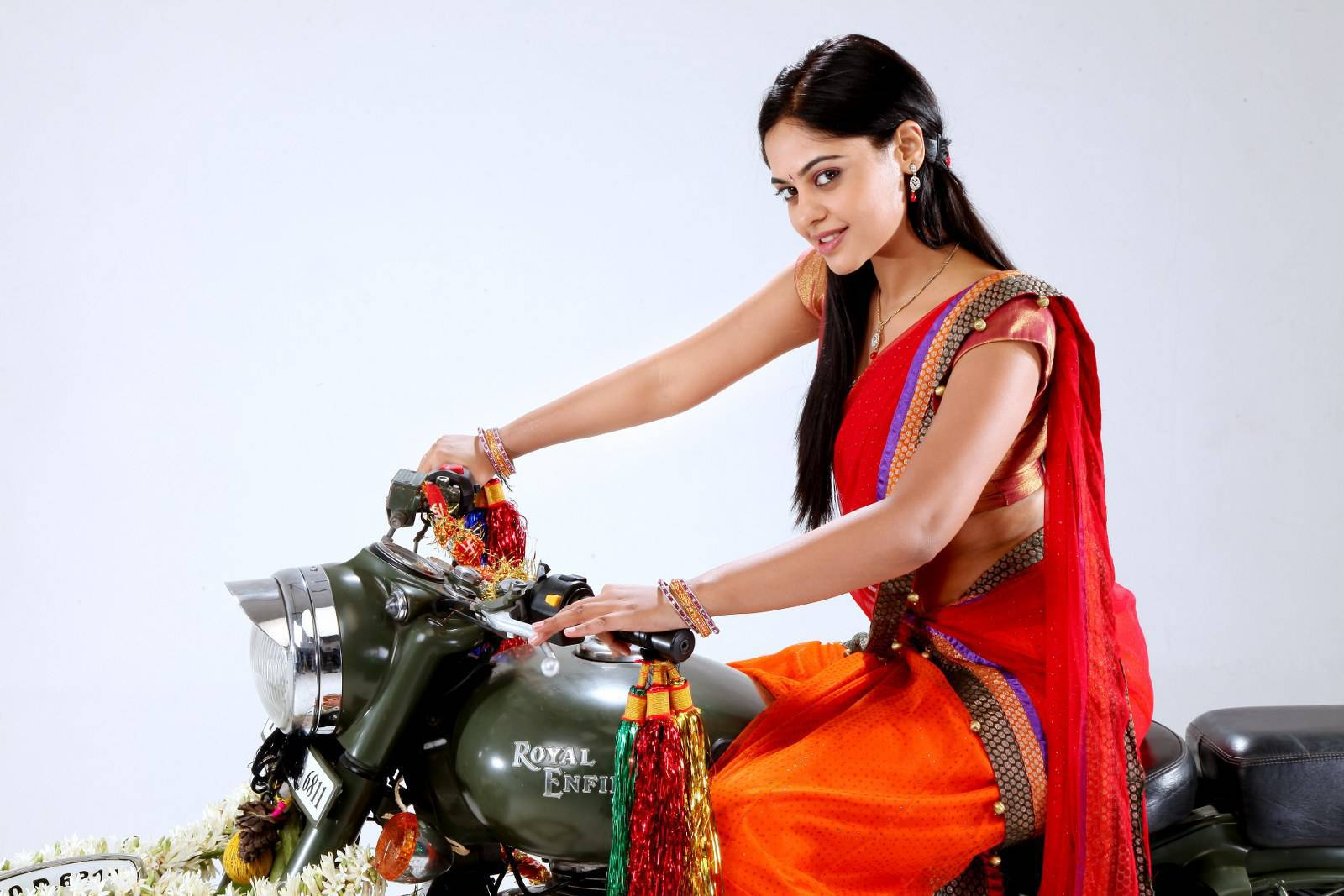 Glamorous Actress Bindu Madhavi Bike Riding Photos