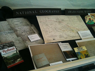 picture of display of images of associated maps and books at A.K. Smiley commemorating Geography Awareness Week 2012