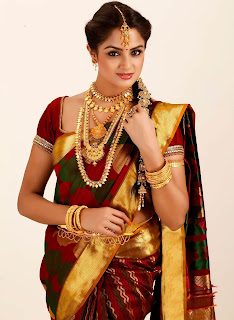 Pattu Sarees with heavy jewelry is definitely worth considering.