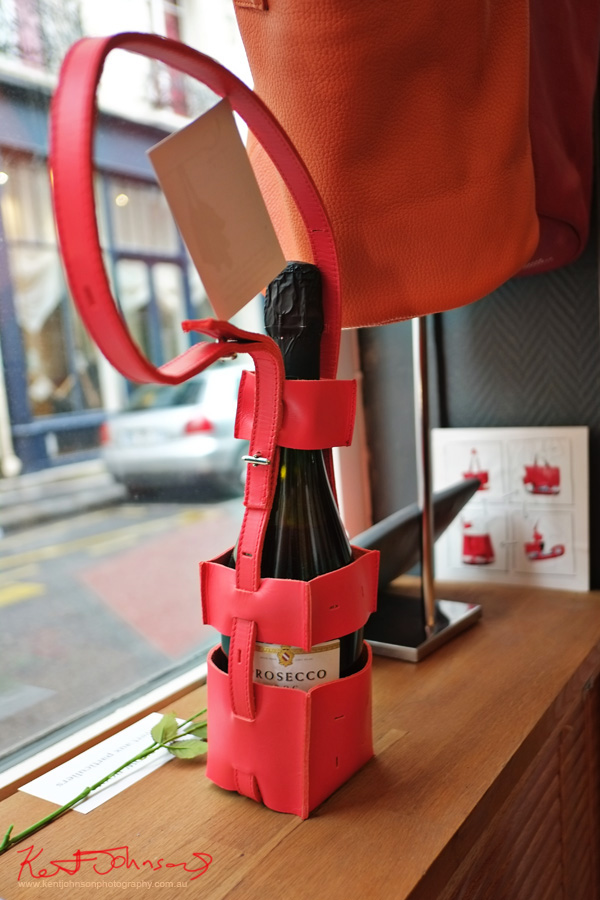 An open leather wine case/handbag  Catherine Loiret on Rue Amélie Paris, France. Photography by Kent Johnson.