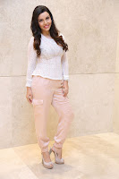 Kyra Dutt in Tight White Top Trousers at Paisa Vasool audio success meet ~  Exclusive Celebrities Galleries 035.JPG