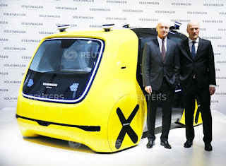 Volkswagen CEO Matthias Mueller (L) and CFO Frank Witter pose next to the self-driving car Sederic at the annual earnings news conference of VW in Berlin in Berlin, Germany, March 13, 2018. (Credit: Reuters/Hannibal Hanschke) Click to Enlarge.