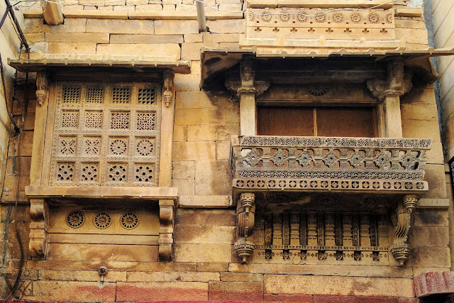 elegantly crafted windows and Jharokhas of houses in Jaisalmer