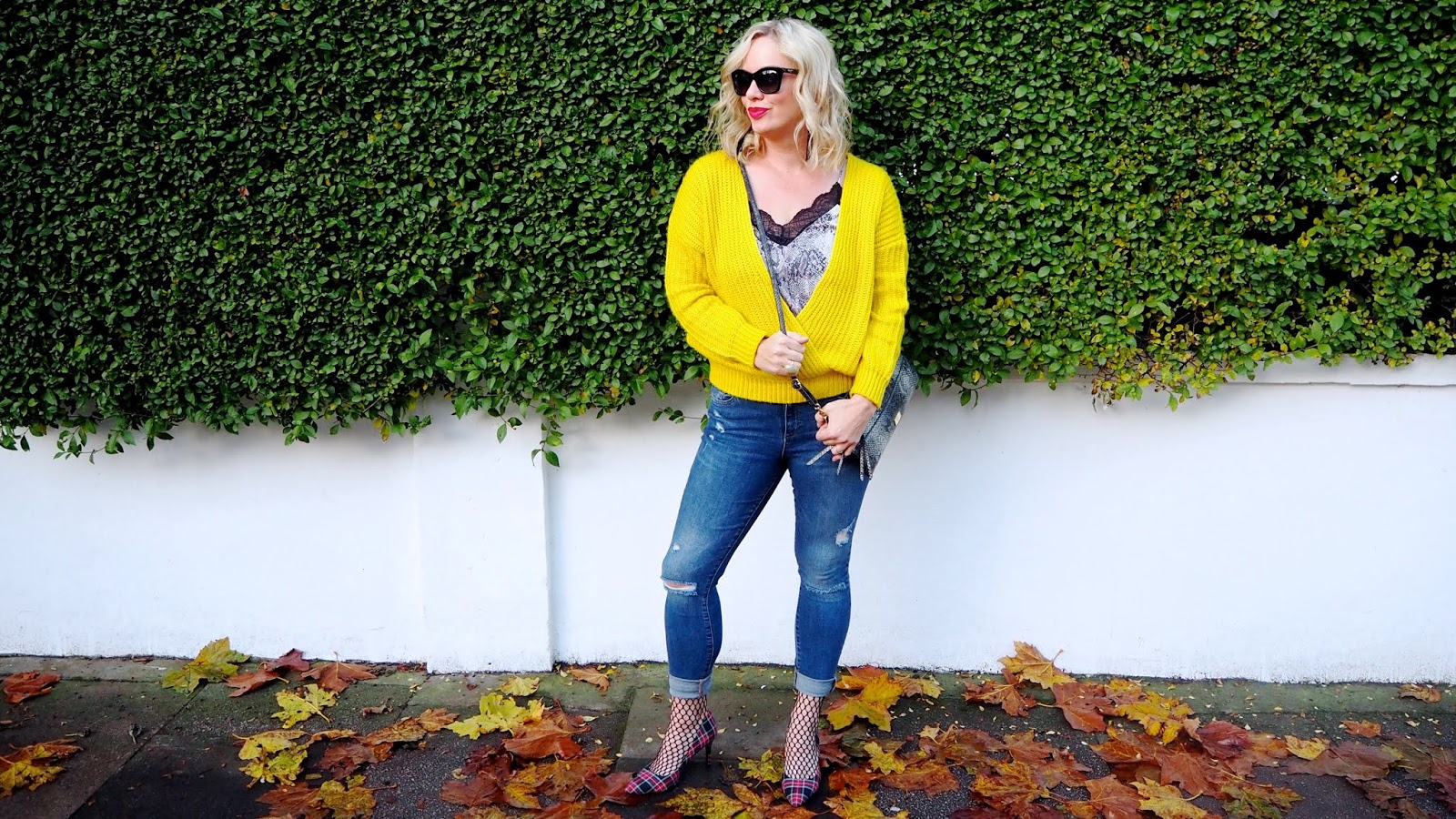 Yellow sweater, snake print camisole, rolled up distressed jeans, fishnet socks and plaid heels.