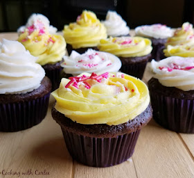 chocolate banana cupcakes with white and yellow sweetened condensed milk frosting and sprinkles