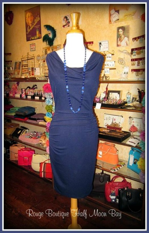 Navy slim cut and form fitting sheath or wiggle dress on display