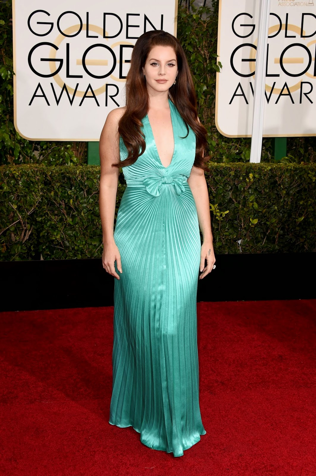 Lana Del Rey sizzles in a retro-style turquoise green dress at the 2015 Golden Globes