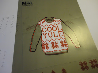 Red and white partially stamped knitted jumper with Cool Yule sentiment