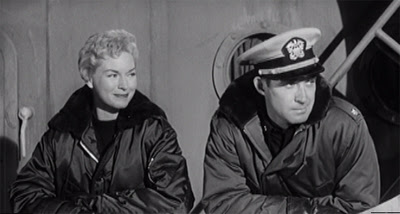 Maggie Hathaway (Shawn Smith) and Cmdr. Roberts (Jock Mahoney) aboard ship