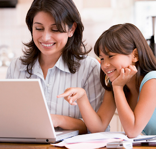Image of mom and daughter on computer