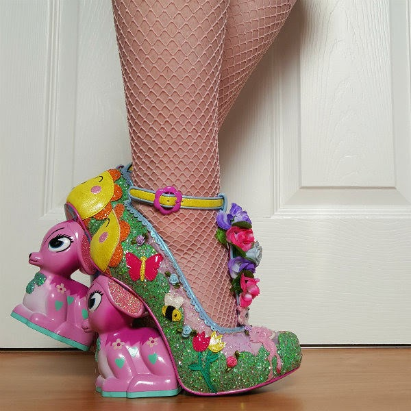 side view of legs wearing lilac deer heeled shoes in green glitter with yellow straps