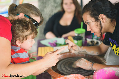 mom and son learning about pottery making