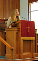 A confirmand is speaking at the pulpit