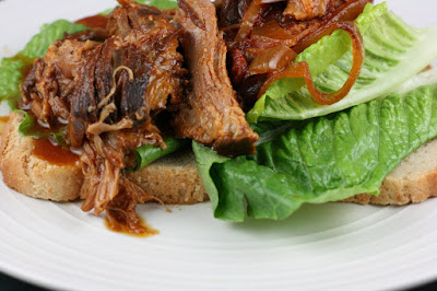 barbecued pulled pork classic crockpot slow cooker recipe from ayearofslowcooking.com