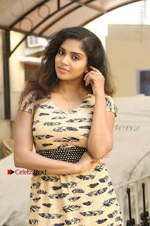 Telugu Actress Karunya Chowdary Stills in Short Dress at ATM Not Working Press Meet  0006.jpg