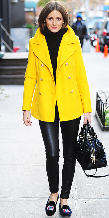3552350e5b1 Olivia Palermo in a yellow Old Navy coat that she teamed with a chunky  sweater