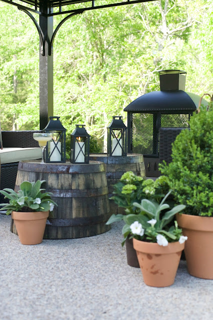 Clay pots with fresh plants on patio