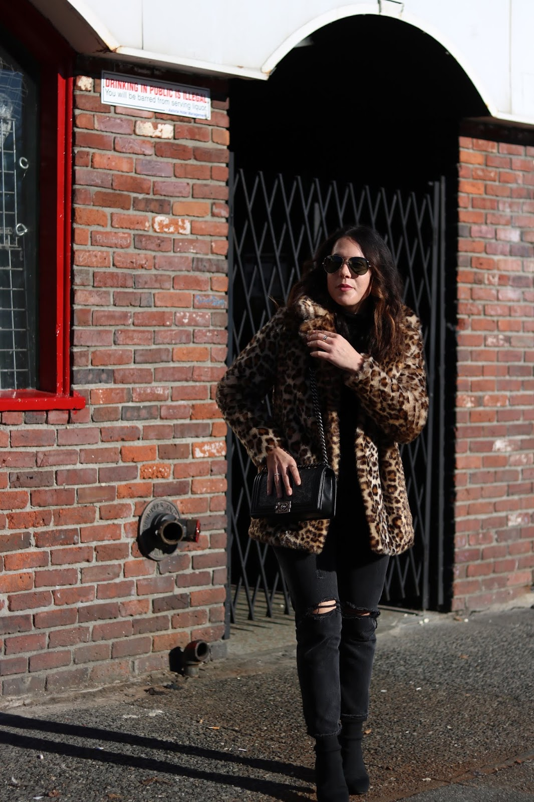 leopard faux fur coat ever new blogger outfit levis wedgie jeans chanel boy bag aleesha harris