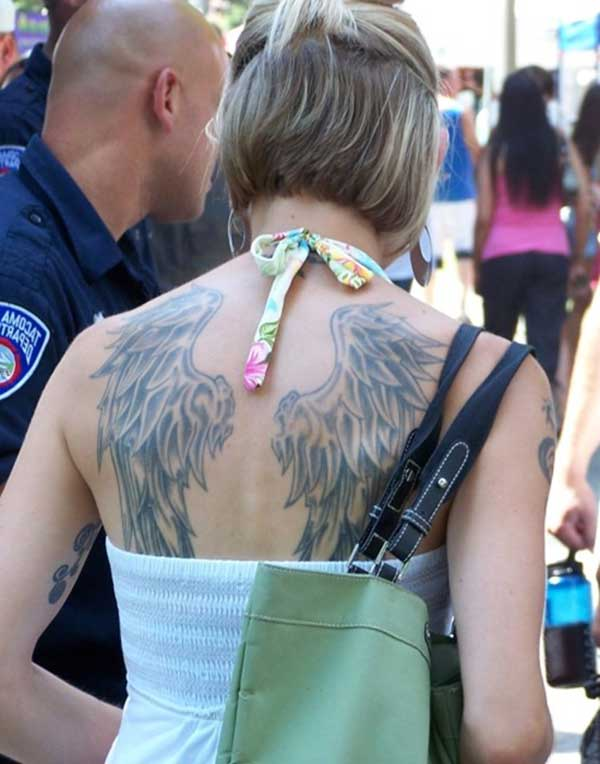 wing tattoo girl