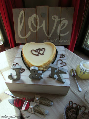 heart shaped cheesecake with chocolate hearts on top