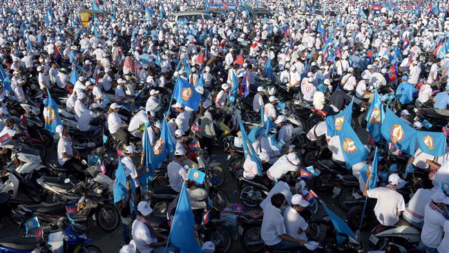 Cambodians join huge campaign rally ahead of local polls