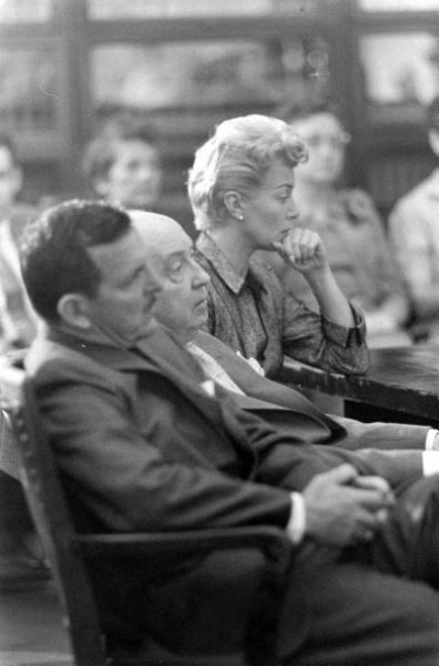 Lana Turner sitting at table with attorneys during inquest for Stompanato's Murder April 1958
