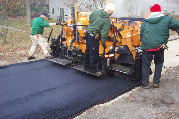 home improvement - asphalt driveway - construction workers