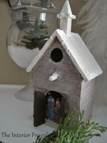 Wrapping a birdhouse with sheet music and faux snow