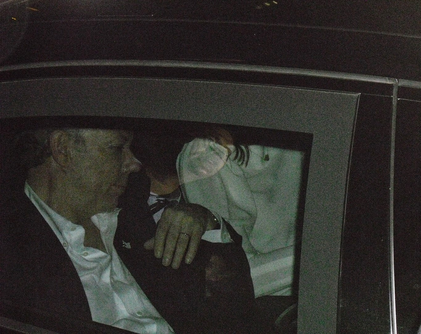 Colombian President Juan Manuel Santos heads off into the night after his re-election victory speech.