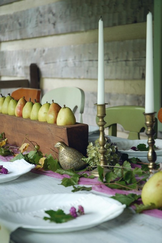 This year I'm using purple, pears in a sugar mold, grapevines, dried hydrangeas, and brass on my outdoor Fall table!