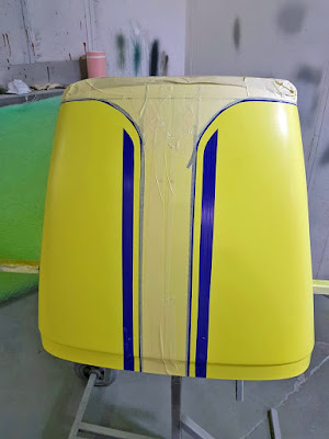 Nose cone sprayed in Sulfur Yellow, then masked with blue fine line tape, where the yellow stripes will be! Confusing!