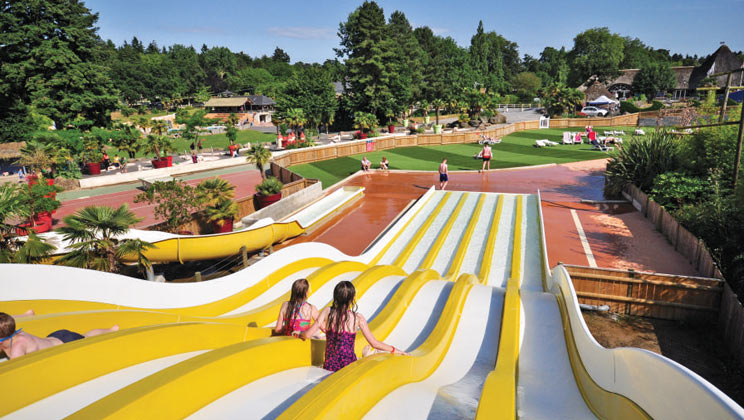 Holiday inspiration for May half term 2019 | Eurocamp's five best-selling parks - Domaine des Omes pool slides