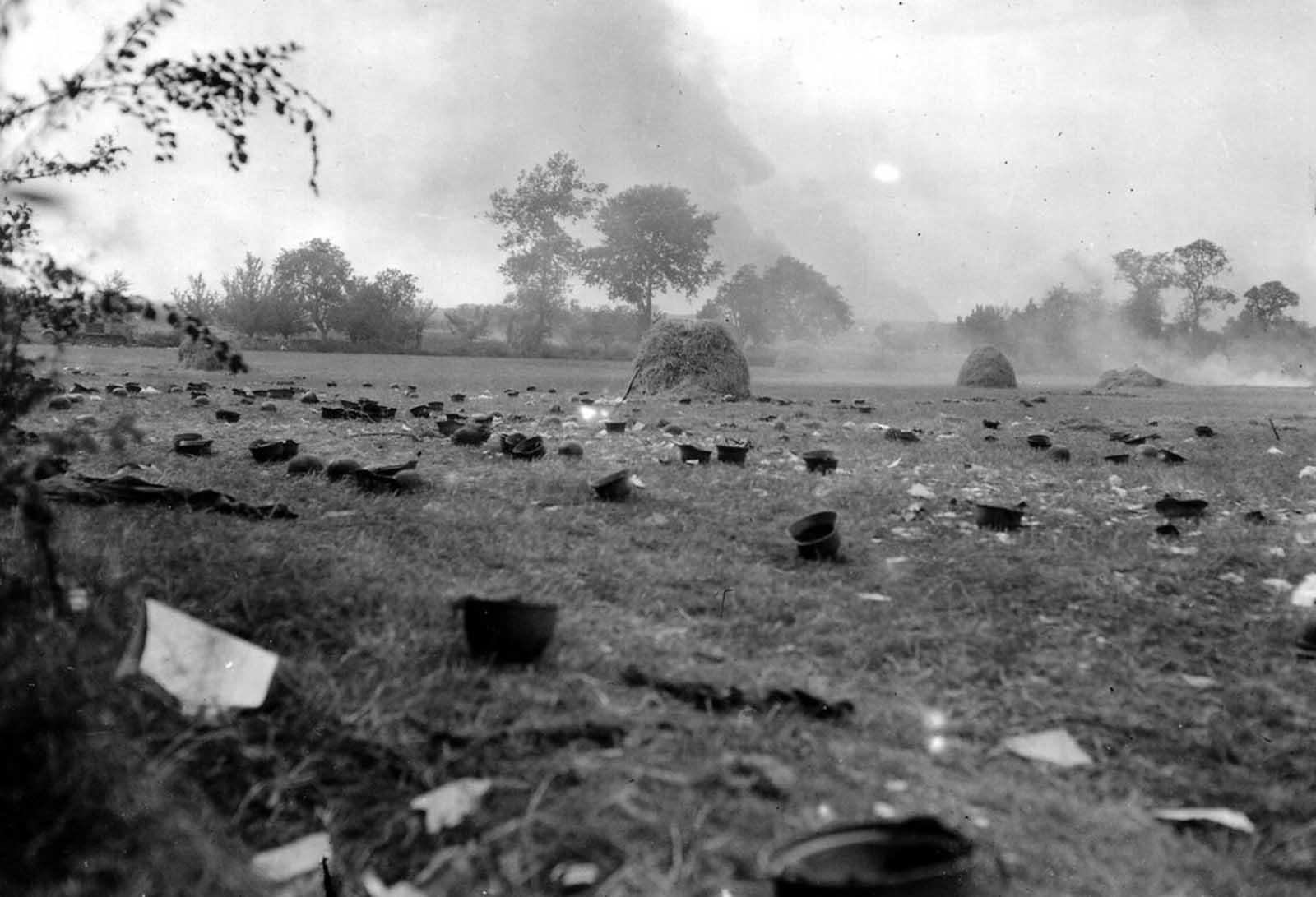 Helmets discarded by German prisoners, who were taken to a prison camp, in a field in Normandy, France in 1944.