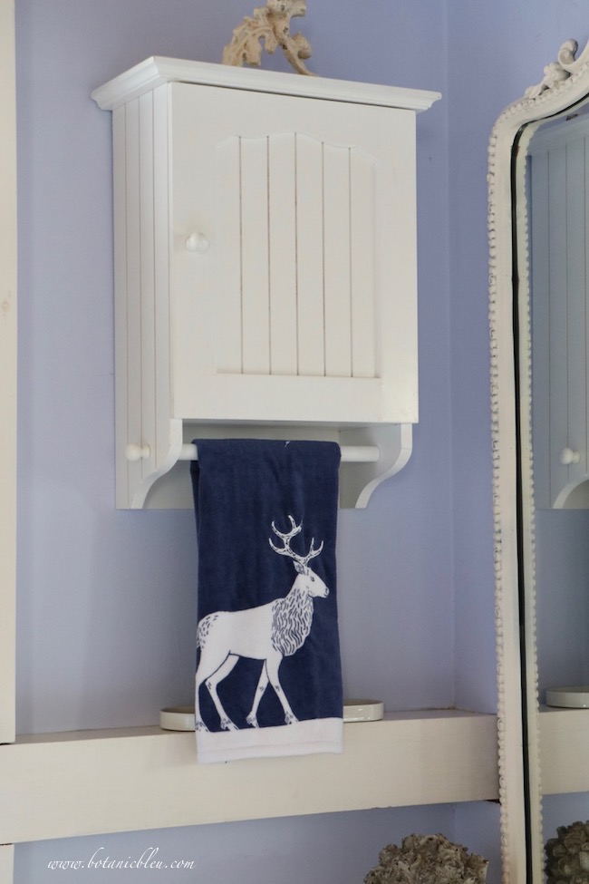 Winter blue and white bathroom white deer on navy hand towel
