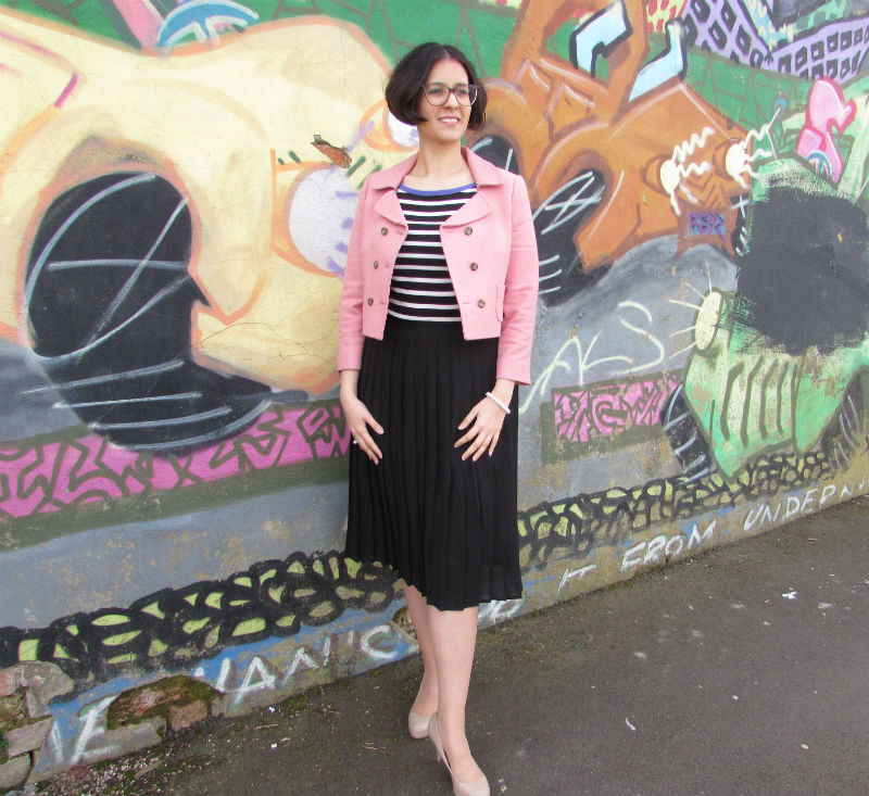 pink blazer and pleated skirt