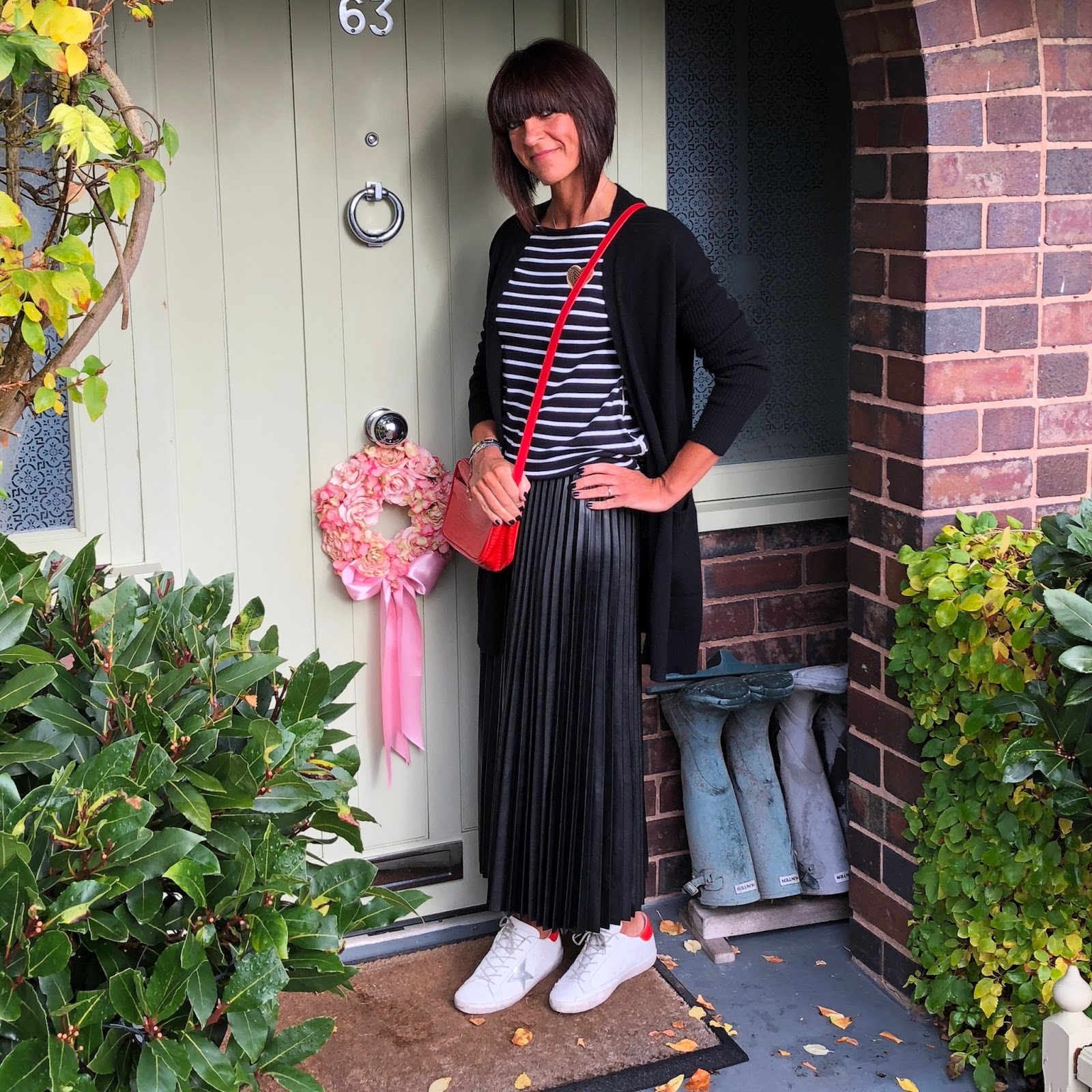 my midlife fashion, uterque mock croc cross body bag, golden goose superstar low top leather trainers, marks and spencer pleated midi skirt, hm breton, marks and spencer pure cashmere textured longline cardigan
