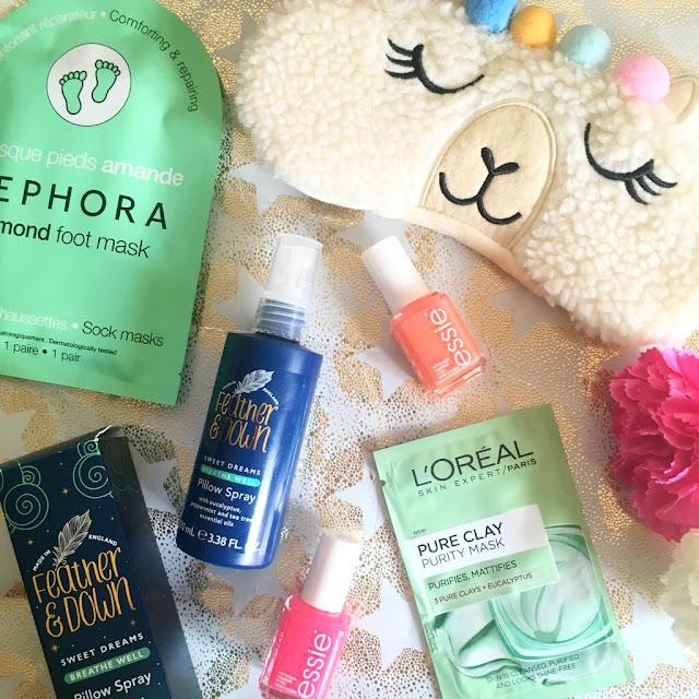 flatlay - nail polish, pillow spray, foot mask, eye mask