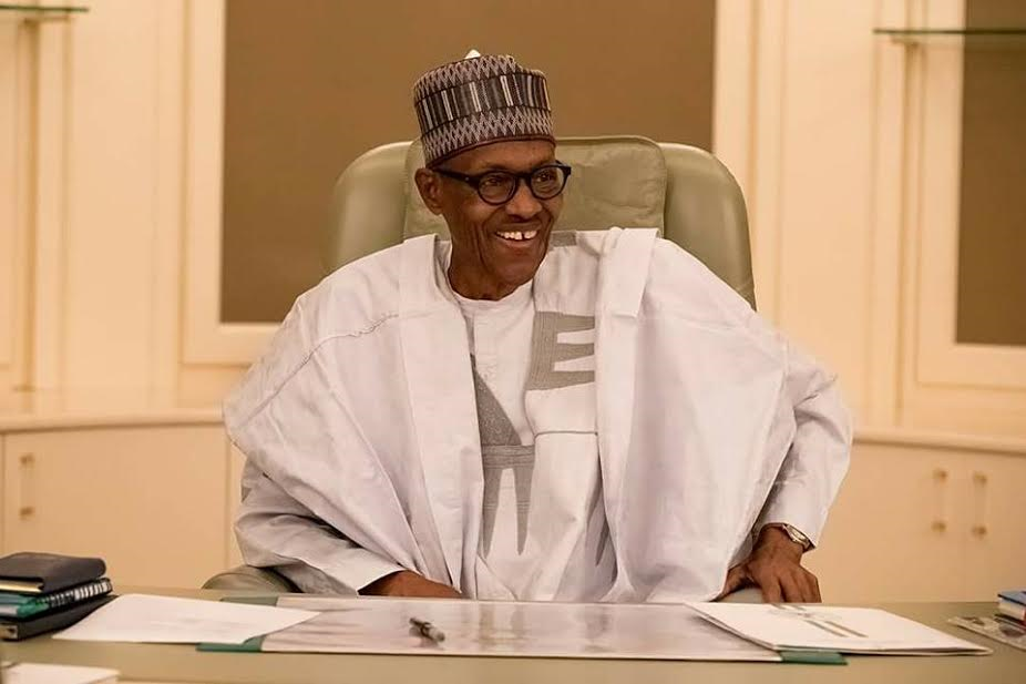 photos of pres buhari in his office as he resumes work today