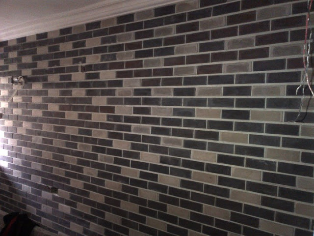 Eco bricks in black and white colors with white grouting