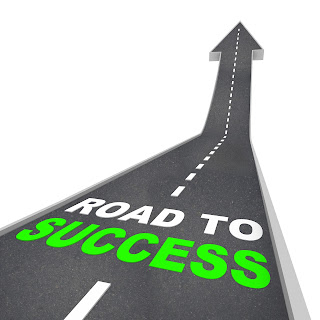 Pic of road turning into upward pointing arrow with word Road to success on it