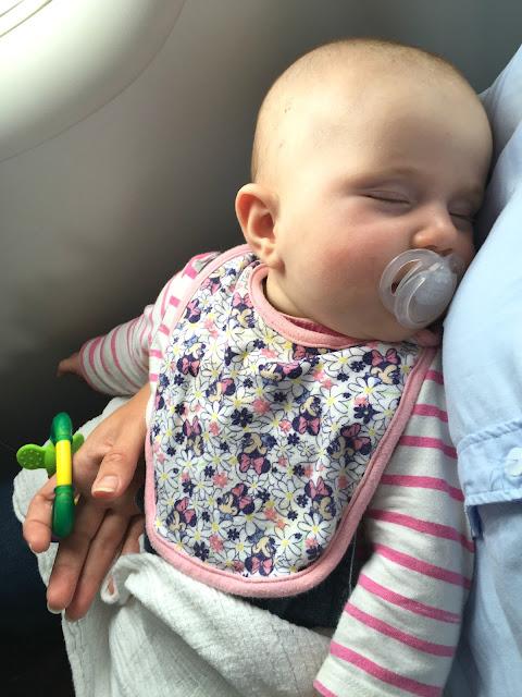 Tin Box Baby sleeping on the plane