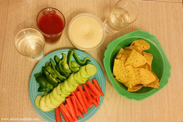 lunch, snack, healthy, hummus, tortilla chips, V8, vegetable juice, water, raw vegetables, carrot sticks, cucumber slices, green peppers, chopped