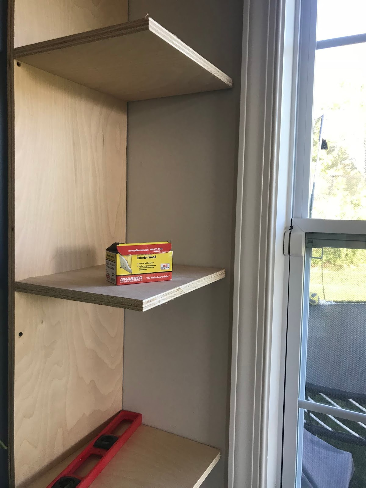 DIY bookcases by windows